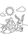 Coloriage Lapin de Pâques avec oeuf de Pâques dans le jardin