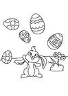 Coloriage Lapin de Pâques joue avec des oeufs de Pâques